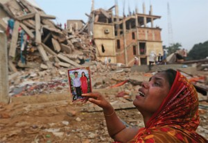 Devastated A mother looks for her son in the debris of Rana Plaza, Dhaka