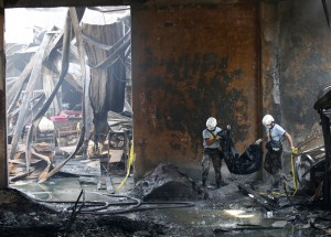 At least 31 people were killed and dozens more are feared dead after a fire razed a footwear factory in the Philippines.